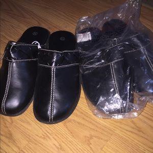 2 Black leather clogs